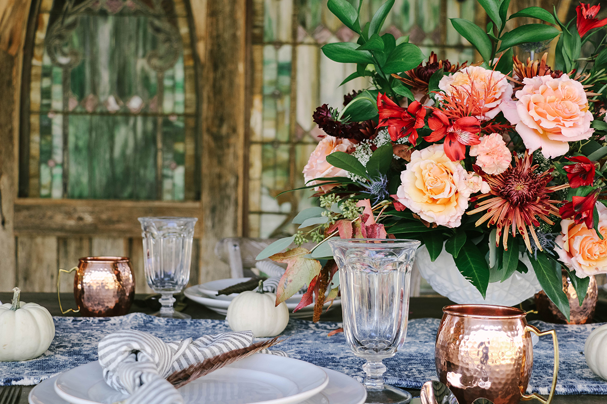 A stylish tasty and nature inspired alfresco friendsgiving styled by herr - Interesting tables capes for christmas providing cozy gathering space ...